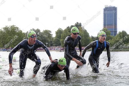 Women's Triathlon - Helen Jenkins (No 10) leaves the water after the 1500m swim