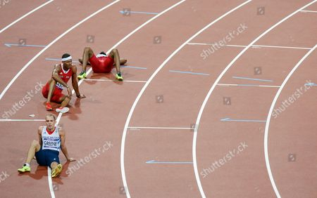 A dejected fourth placed Dai Greene reacts after the Men's 400m final