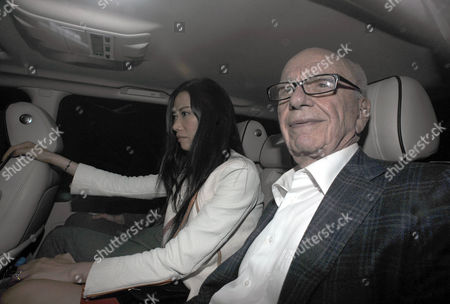 Editorial photo of Rupert Murdoch Arrives Back Home To His Mayfair Flat Tonight At 10pm With His Wife. His Son Lachlan Is Next To Rupert's Wife Wendy Deng But Is Obscured In This Picture. 19th July Pic By James Emmett.