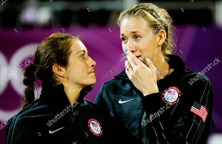 Misty May-Treanor and Kerry Walsh Jennings of USA stand on the podium and await their gold medals after the Beach Volleyball final