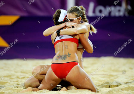 Misty May-Treanor of USA and Kerry Walsh Jennings of USA celebrate their gold medal after the Women's Beach Volleyball Final