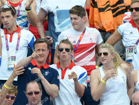 Stock Photo of David Carry, finance of Keri-Anne Payne stands inbetween British Prime Minister David Cameron and Rebecca Adlington as they cheer on Keri-Anne Payne during the Women's 10k Marathon Swimming