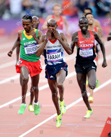 Mo Farah of Great Britain celebrates winning the Men's 5000m Final, Dejen Gebremeskel (silver)