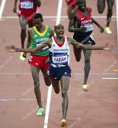 Britain's Mo Farah wins the men's 5000m final, Dejen Gebremeskel (silver)