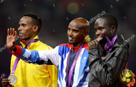 Mo Farah wins the 5000m, Dejen Gebremeskel (silver), Thomas Pkemei Longosiwa (bronze)