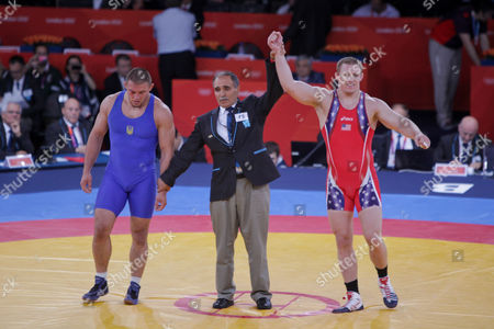 Jake Varner (red top) of the United States winning  the gold medal in the men's 96-kilogram freestyle wrestling on the final day of the Olympic Games. He beat Valerii Andriitsev of Ukraine 1-0, 1-0 to claim first place in the event