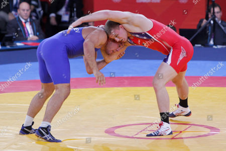Stock Picture of Jake Varner (red top) of the United States winning  the gold medal in the men's 96-kilogram freestyle wrestling on the final day of the Olympic Games. He beat Valerii Andriitsev of Ukraine 1-0, 1-0 to claim first place in the event