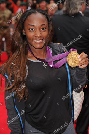 Stock Photo of Bianca Knight with Olympic Gold Medal