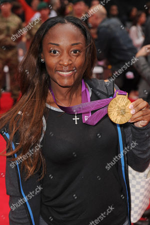 Stock Picture of Bianca Knight with Olympic Gold Medal