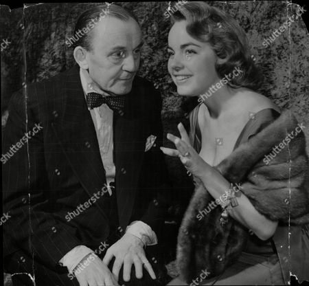 Stock Picture of Actress Terry Moore With Actor Henry Oscar At The Dorchester Hotel.