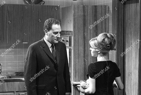 Stanley Meadows as Hollins and June Barry as Joan