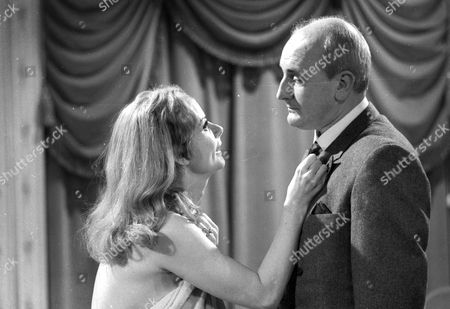 Genevieve Page as Camille and Michael Barrington as Dr Mannard