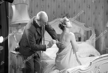 Michael Barrington as Dr Mannard and Genevieve Page as Camille