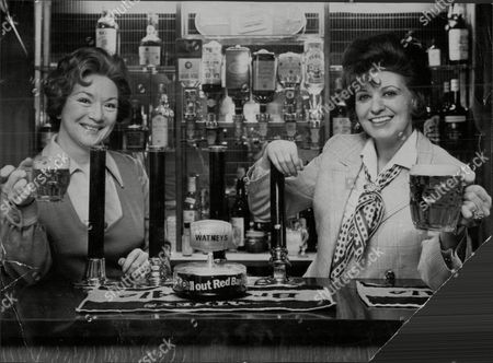 Actress Pat Phoenix With Joan Francis Behind The Bar Of Her Own Pub. She Is The Landlady Of The 200 Year Old Navigation Pub In Buxworth Derbyshire.
