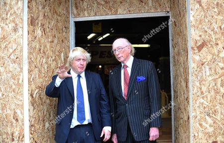Editorial photo of Mayor Of London Boris Johnson Was Out And About In Croydon On Friday Meeting Tfl Workers Who Got The Trams Running Again And Shopkeepers Whose Properties And Stock Were Damaged And Stolen. Boris Meets Maurice Reeves Owner Of The Famous Furniture Stor