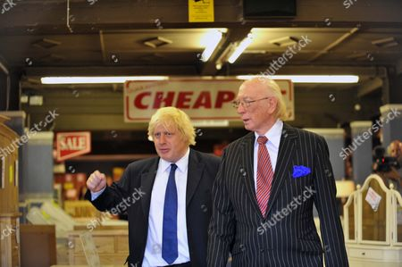 Stock Image of Mayor Of London Boris Johnson Was Out And About In Croydon On Friday Meeting Tfl Workers Who Got The Trams Running Again And Shopkeepers Whose Properties And Stock Were Damaged And Stolen. Boris Meets Maurice Reeves Owner Of The Famous Furniture Store In Croydon Which Was Damaged