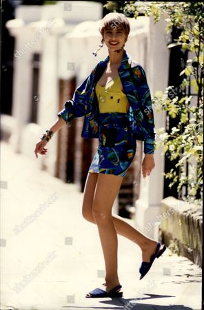 Editorial image of Blue Print Jacket A159 Matching Skirt A112 By Irie Swimsuit A95 By Galliano All From Joseph Sloane Street In London Sw1 Fulham Road Sw1 Blue Suede Sandals A94.50 By Charles Jourdan Brompton Road Swa. Earrings A96 Bracelet 148 By Chantal.