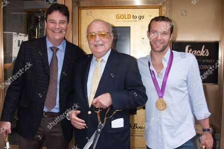 Greg Roberts, Ceo of Spectrum Group International, Harvey Stack, owner of Stack's coin shop and Brendan Hansen