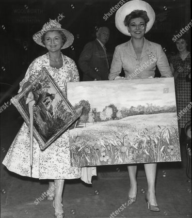 Actresses Hy Hazell And Avril Angers Holding Paintings From Michael Dennism On Their Way To Victoria Station In London.