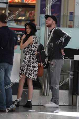 Stock Photo of Cher Lloyd and fiance Craig Monk