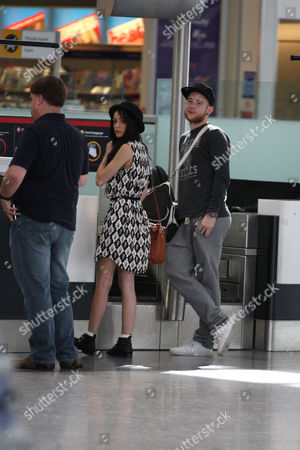 Stock Picture of Cher Lloyd and fiance Craig Monk
