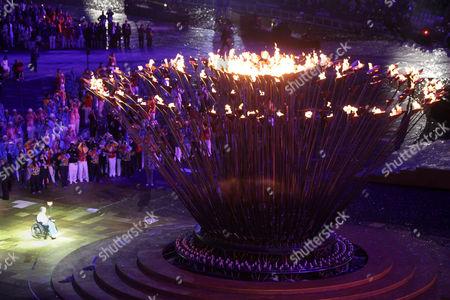 Margaret Maughan lighting the flame