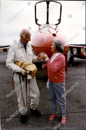 Test Pilot Neville Duke And Wife Gwen Duke With A Hawker Hunter Jet Squadron Leader Neville Frederick Duke Dso Obe Dfc & Two Bars Afc Fraes Czech War Cross (11 January 1922 A 7 April 2007) Was A British Second World War Fighter Pilot. He Was The Top Allied Flying Ace In The Mediterranean Theatre Having Shot Down At Least 27 Enemy Aircraft And Was Acknowledged As One Of The World's Foremost Test Pilots After The War. In 1953 He Became Holder Of The World Air Speed Record When He Flew A Hawker Hunter F Mk3 At 727.63 Mph Over Littlehampton In The Uk. He Became A Well-known Celebrity In The Coronation Year Of Queen Elizabeth Ii Alongside Footballer Stanley Matthews Actor Dirk Bogarde And Mountaineer Edmund Hillary.