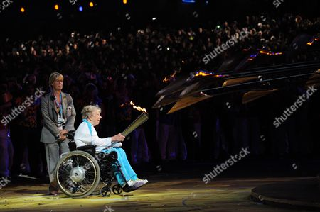 Stock Image of Britain's first Paralympic gold medalist Margaret Maughan lights the cauldron bearing the Paralympic Flame