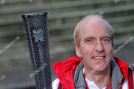 Stock Photo of Paralympian cyclist Simon Richardson with his Paralympic torch