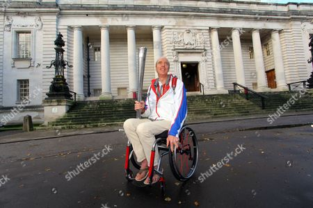 Stock Picture of Paralympian cyclist Simon Richardson with his Paralympic torch