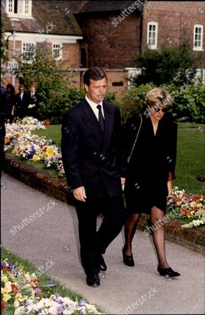 Racing Driver Derek Warwick Consoles His Sister Linda At The Funeral Of Paul Warwick.