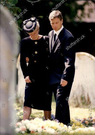 Racing Driver Derek Warwick Consoles His Mother Beattie At The Funeral Of Paul Warwick.