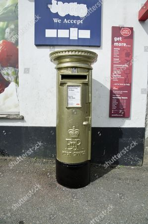 Royal Mail Post Box painted gold in honour of Jonathan Fox's gold medal win at the London 2012 Paralympic Games