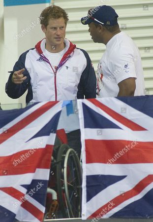 Prince Harry watching The GB Paralympic Swimmers in action  Harry meets Derek Derenalagi