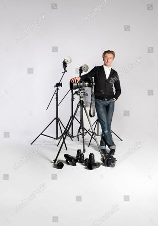 Portrait Of Celebrity Photographer John Wright Posing With A Selection Of His Favourite Equipment
