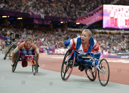 Hannah Cockroft of Great Britain (R) celebrates with Melissa Nicholls after winning a Gold medal during the Women's 200m T34 Final
