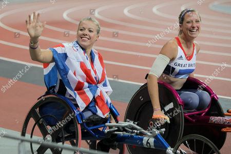 Hannah Cockroft and Melissa Nicholls doing a lap of honour after Cockroft won the T34 200m final