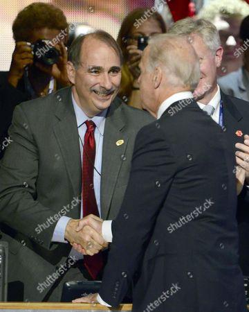 Vice President Joe Biden (R) shakes hands with David Axelrod
