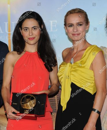 Director Lucy Mulloy poses with Sandrine Bonnaire
