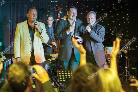 Bobby Davro, Tony Hadley and Mark Adam sing
