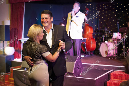 Stock Image of Tony Hadley Dances With Wife to Mark Adam singing