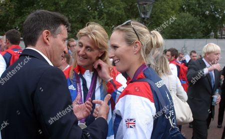 Lord Sebastian Coe talks with team-mates Kristina Cook and Zara Phillips, with Boris Johnson in the background