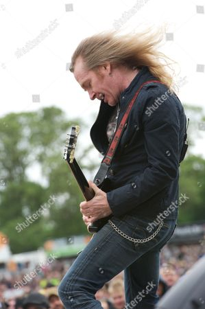 Derby United Kingdom - June 9: Doug Scarratt Of English Heavy Metal Band Saxon Performing Live Onstage At Download Festival June 9