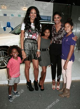 Kimora Lee Simmons with daughters Aoki Lee (left) and Ming Lee (right) and son Kenzo Lee Hounsou and Rachel Roy