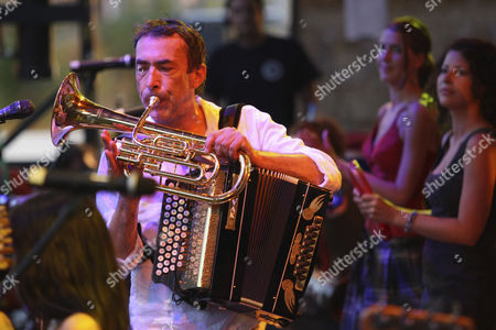 Stock Picture of Alpine Rock musician Hubert von Goisern with a wind instrument and an accordion