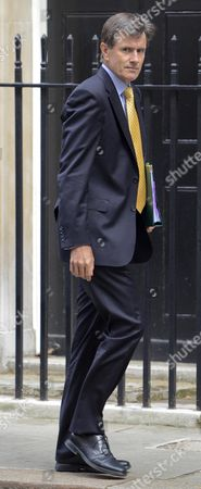 The head of MI6 Sir John Sawers arriving at No10 Downing Street