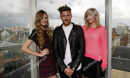 Stock Photo of Henry Holland with models in his outfits, Caron Kinnaird (19 tartan dress) and Melanie McDonald (21, pink top)