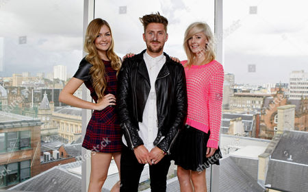 Stock Picture of Henry Holland with models in his outfits, Caron Kinnaird (19 tartan dress) and Melanie McDonald (21, pink top)