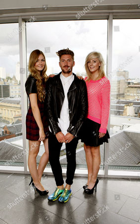 Stock Image of Henry Holland with models in his outfits, Caron Kinnaird (19 tartan dress) and Melanie McDonald (21, pink top)