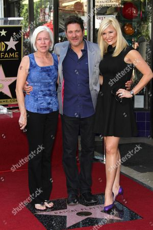 Jay DeMarcus with his mother and wife Allison Alderson